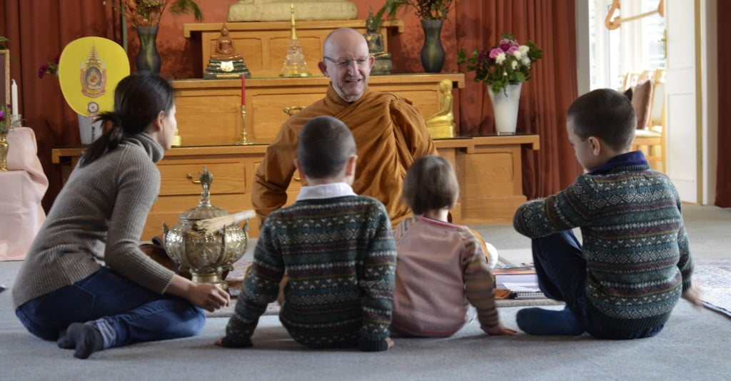 Ajahn Amaro answering questions in the sala